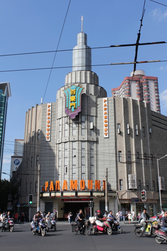 Paramount Theatre, builtin in 1933 by wealthy Chinese businessman Gu Liancheng, marks the start of Shanghai's centre of glamour and glitz along Bubbling Well Road.
