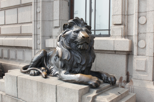 One of the pair of lions at the entrance to the former Hong Kong  and Shanghai Bank Building on the Bund.