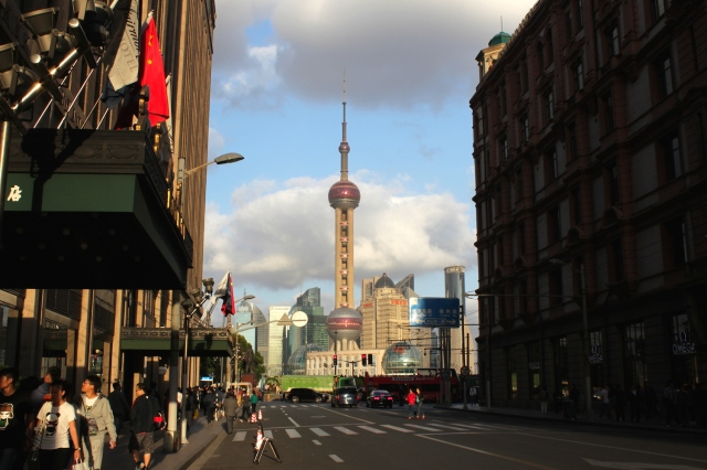 Nanking Road today ends with a view of Pudong and the Oriental Pearl Tower.  to the left is the famous Cathay Hotel; to the right, in the shadow, the equally famous Palace Hotel.
