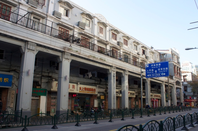 Rows of shophouses behind the French Bund recall those in Canton.