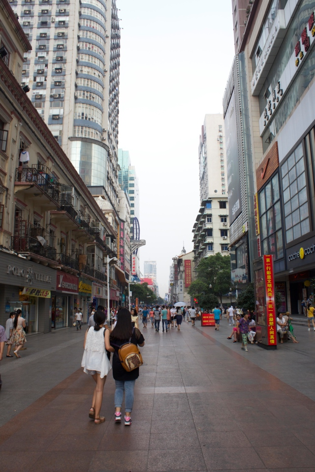 Young girls walking down Jianghan Pedestrian Street in the British Concession - the city's foremost shopping strip, then and now. It is the equivalent of Nanking Road in Shanghai.