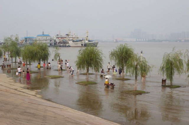 Locals playing in the flooded river-side promenade.