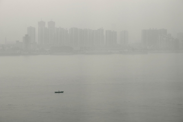 A lone boat on the river in the early morning. 孤舟簑笠翁。。。