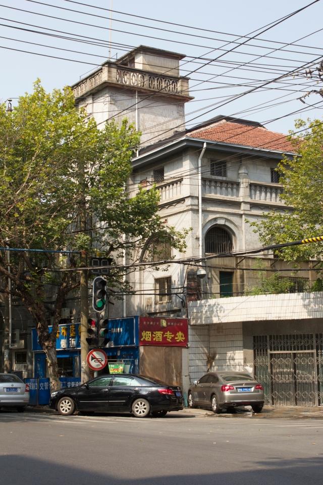 German villa behind contemporary facade.