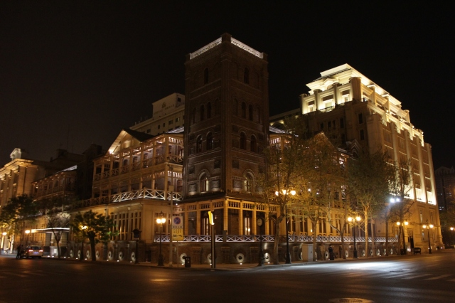 The Astor Hotel at night.