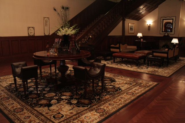 The former lobby space, looking like the living room of a large, Victorian hunting lodge (minus the trophies).