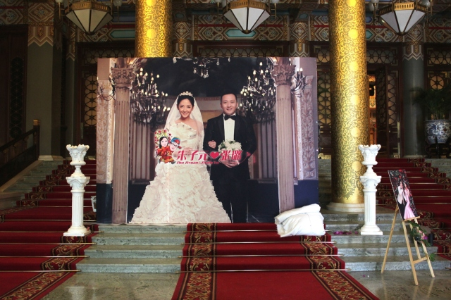 The over-the-top wedding banquet taking place within the hotel.