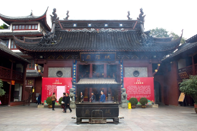The interior of the City God temple, smokey with incense.  This is a Taoist Temple.