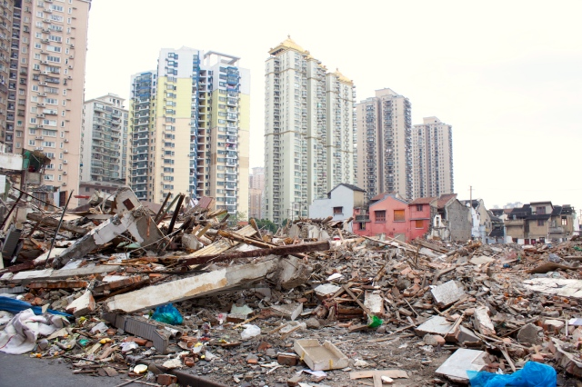 Whole tracts of old residences already destroyed, and the high-rises being built in their place.