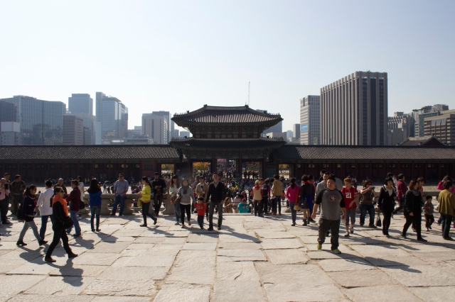 A view from within the Gyeongbukgong Palace towards the skyscrapers of modern-day Seoul.