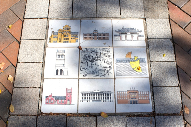 Specialty tiles laid into the pavement showing the key sights in Jeong-dong.