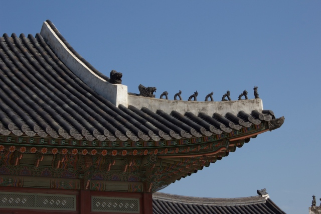 Close-up of traditional roofs, betraying influence of Ming dynasty palace architecture like in the Forbidden City in Beiijing.