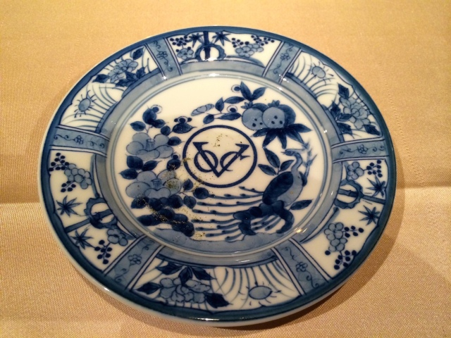 The logo of the Dutch East India Company, on a reproduction trade ceramic plate.