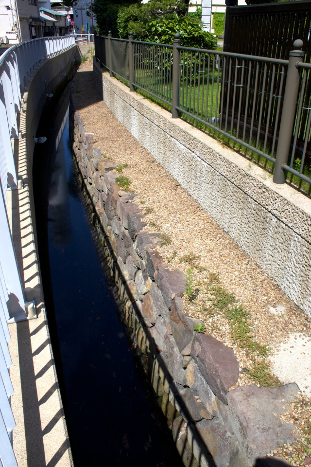 The exposed original perimeter walls of Dejima.