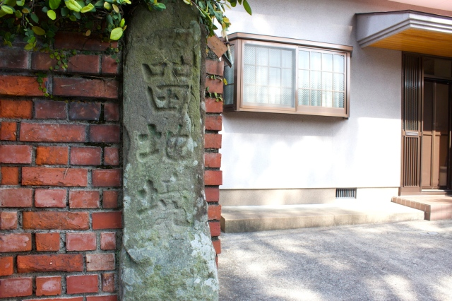 An old stone marker indicating the boundary of the Oura Foreign Settlement.