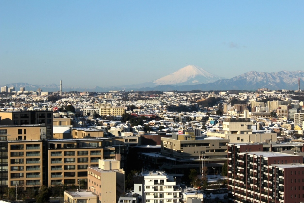 View of Mount Fuji in the distance, on a clear day.
