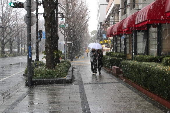 Snow on the streets by the Hotel New Grand.