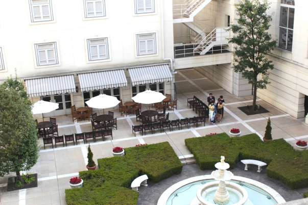 View of the Central Courtyard, and a family gathered for a wedding.