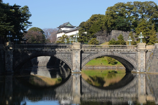 "The Nijubashi 二重橋 is actually two bridges - the 正門石橋 (Seimon Ishibashi), or ""Main Entrance Stone Bridge"" which one sees here, is the first bridge."