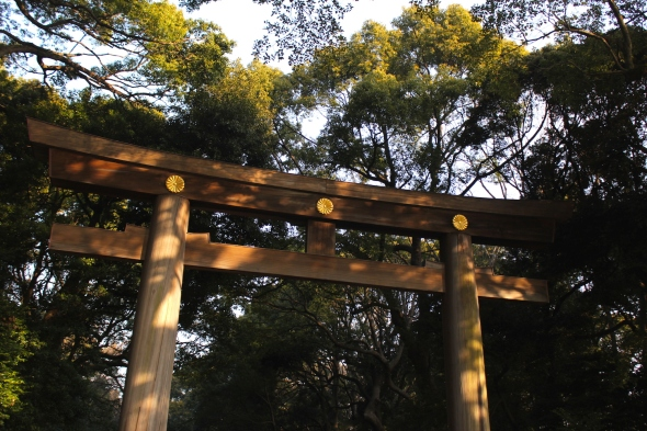 A torii marks the entrance to the Meiji Shrine.